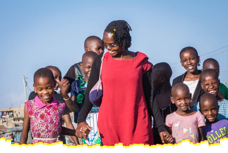 Margret walking with children in Soweto slums