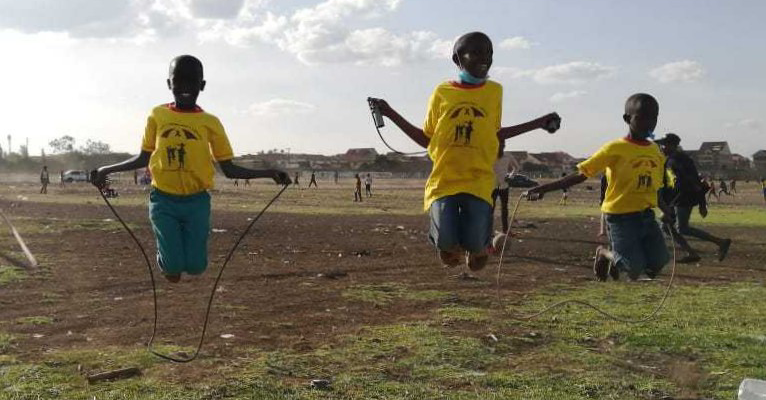 Children rope skipping at Jacaranda grounds